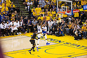 Golden State Warriors forward Kevin Durant (35) dunks the ball as Cleveland Cavaliers guard Iman Shumpert (4) hangs onto him during Game 2 of the NBA Finals at Oracle Arena in Oakland, Calif., on June 4, 2017. (Stan Olszewski/Special to S.F. Examiner)