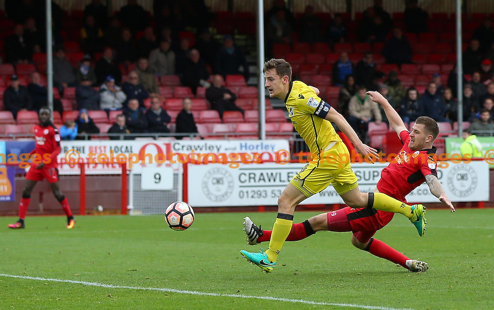 Crawley's James Collins attempts on goal is thwarted by Tom Lockyer of Bristol Rovers during the FA Cup match between Crawley Town and Bristol Rovers at the Checkatrade Stadium in Crawley. November 5, 2016.<br /> James Boardman / Telephoto Images<br /> +44 7967 642437