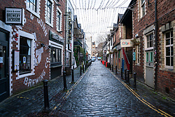 Glasgow, Scotland, UK.1 December 2020. Glasgow remains under level 4 lockdown and non essential businesses, bars and restaurants are closed. Pictured; Ashton Lane in the West End is empty with bars closed.   Iain Masterton/Alamy Live News