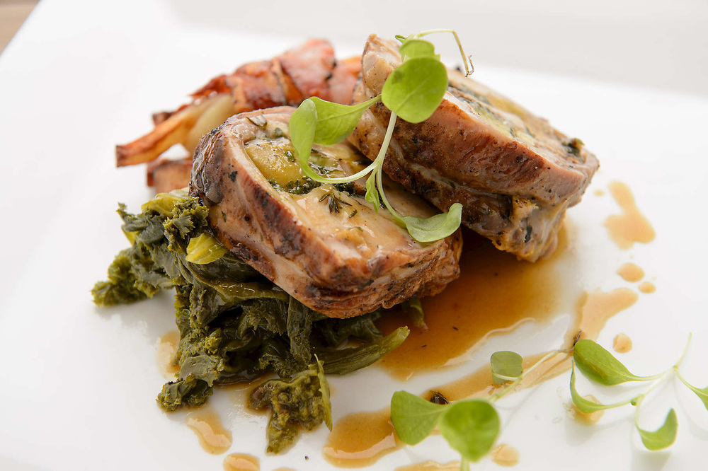 Image of a plate of Roast Pork photographed at the Chef's Table in Stuart Florida as part of a restaurant advertising campaign.