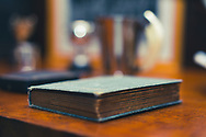 Small old book on a side table