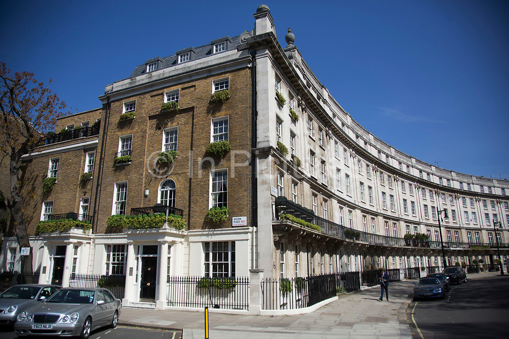 Wilton Crescent is one of the most sought after addresses in Belgravia. Characterised by grand terraces with lavish white houses which are built in a crescent shape, many of them with stuccoed balconies. In a selected few boroughs of West London, wealth has changed over the last couple of decades. Traditionally wealthy parts of town, have developed into new affluent playgrounds of the super rich. With influxes of foreign money in particular from the Middle-East. The UK capital is home to more multimillionaires than any other city in the world according to recent figures. Boasting a staggering 4,224 'ultra-high net worth' residents - people with a net worth of more than $30million, or £19.2million.. London, England, UK.