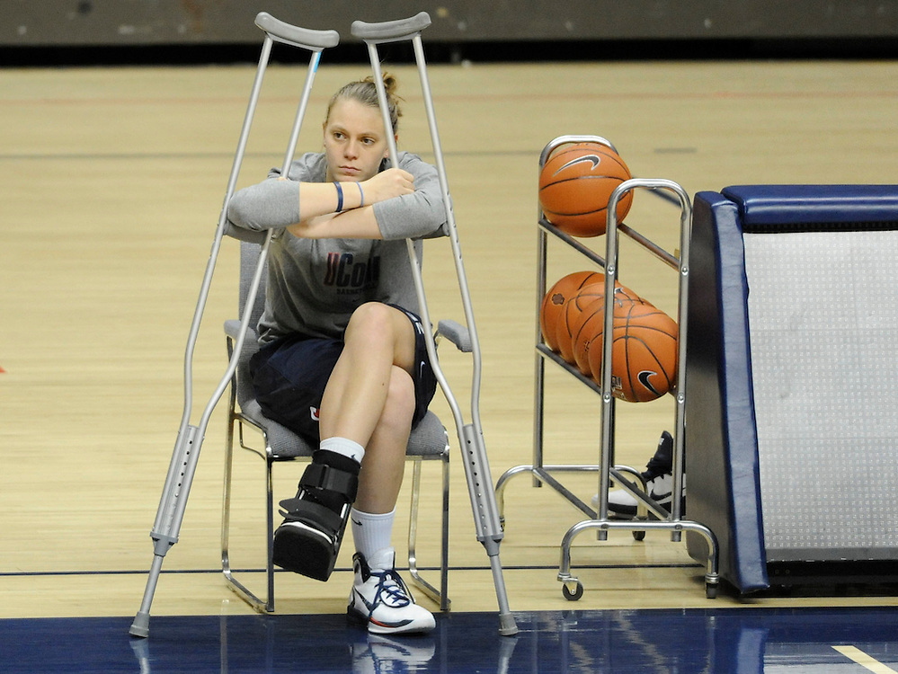 Injured player Heather Buck watches her team practice at the University of Connecticut in Storrs, Conn. (AP Photo/Jessica Hill)