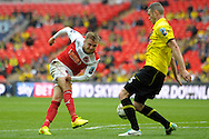 Fleetwood Town's David Ball has a shot blocked by  Burton Albion's Zander Diamond . Skybet football league two play off final match , Burton Albion v Fleetwood Town at Wembley Stadium in  London on Monday 26th May 2014.<br /> pic by John Patrick Fletcher, Andrew Orchard sports photography.