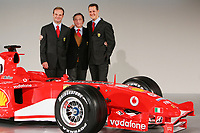 (L to R) Brazilian Ferrari driver Rubens Barrichello, team manager Jean Todt and German Michael Schumacher pose for photographers during the official presentation of the new F2005 F1 car at the team's headquarters in Maranello.<br /> <br /> <br /> <br /> Rubens Barrichello, Jean Todt e Michael Schumacher  durante la presentazione della nuova Ferrari F2005.<br /> <br /> <br /> <br /> Photo Munch / Graffiti