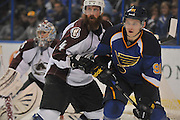 Colorado Avalanche defenseman Greg Zanon (4) and St. Louis Blues right wing Vladimir Tarasenko (91) scuffle for position in front of the Avalanche goal in the third period during a game between the Colorado Avalanche and the St. Louis Blues on Tuesday April 23, 2013 at the Scottrade Center in downtown St. Louis.  In background at left is Colorado Avalanche goalie Semyon Varlamov (1).  The Blues won, 3-1.