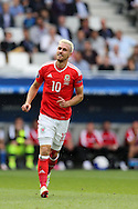 Aaron Ramsey of Wales looks on. Euro 2016, Wales v Slovakia at Matmut Atlantique , Nouveau Stade de Bordeaux  in Bordeaux, France on Saturday 11th June 2016, pic by  Andrew Orchard, Andrew Orchard sports photography.