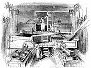 Mixing and grinding ingredients for production of pottery in the mill room of a Staffordshire factory. Wood engraving c1851