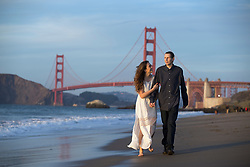 John Harris, right, and fiancee Christi Kelley, both of Concord, Calif., pose for an engagement portrait at Baker Beach in San Francisco, Tuesday, Nov. 21, 2017. (Photo by D. Ross Cameron)