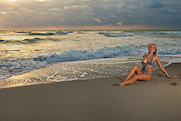Young Caucasian girl relaxing in the beach at sunrise.