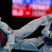 Franka Anic, Slovenia, (red) in action against Gulnafis Aitmukhambetova, Kazakhstan, during the Taekwondo Women 67kg preliminary round during the London 2012 Olympic games. London, UK. 10th August 2012.