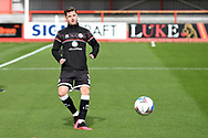 Josh Doherty (3) of Crawley Town warms up before the EFL Sky Bet League 2 match between Cheltenham Town and Crawley Town at Jonny Rocks Stadium, Cheltenham, England on 10 October 2020.