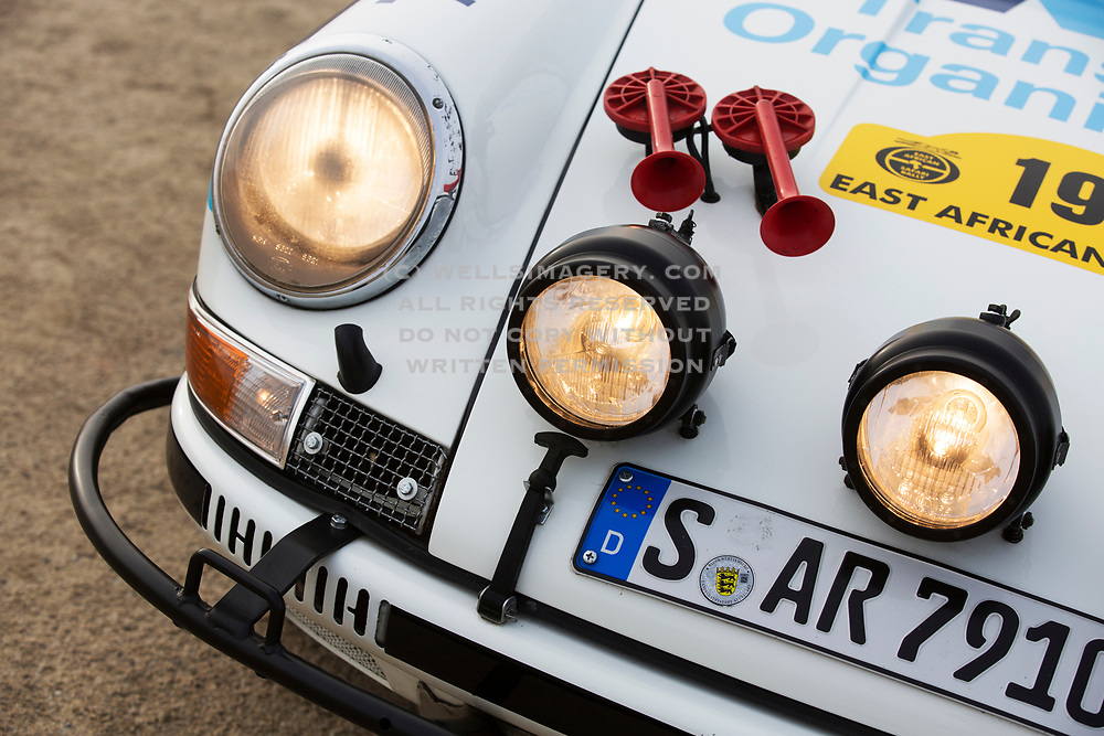Image detail of the 1973 Porsche 911 Carrera RS, Race Number 19, which took part in the 1974 East African Rally in Kenya, Africa. Photographed in Monterey, California, American Southwest by Randy Wells