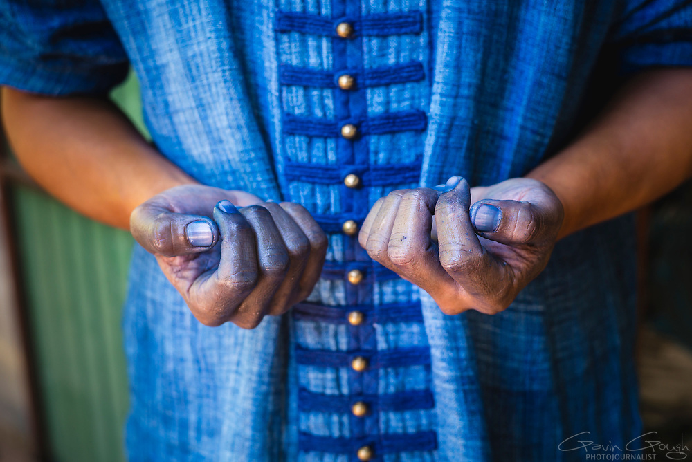 A man's hands dyed blue from working with indigo dye in a traditional factory, Indigo Dyeing Factory, Sakhon Nokhon, Thailand