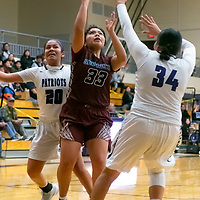 Photo: Jeffery Jones<br /> <br /> Shiprock Lady Chieftain Sanaa Keeswood (33) takes a shot at the basket while Miyamura Lady Patriots Noelle Charleston (20) and Tatum Bennett (34) try to defend against her Thursday night at Miyamura High School in Gallup. The Lady Chieftains won 49-36.