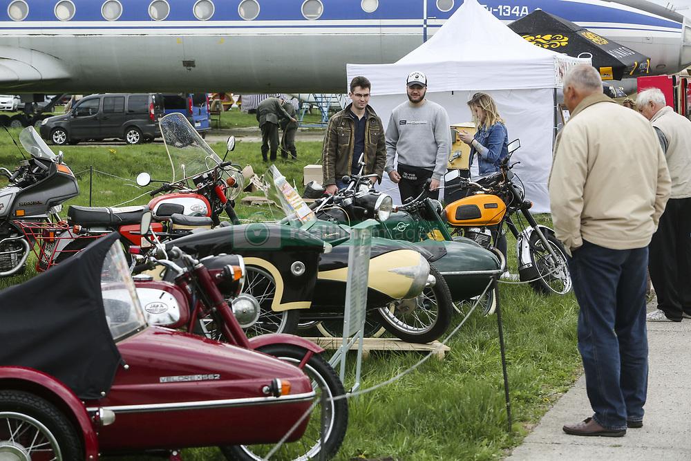 April 27, 2018 - Kiev, Ukraine - People look at a Soviet era motorcycles  during an Old Car Land show at Aviation Museum in Kyiv, Ukraine, April 27,   2018  (Credit Image: © Sergii Kharchenko/NurPhoto via ZUMA Press)