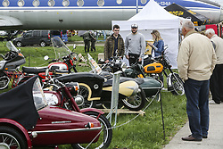 April 27, 2018 - Kiev, Ukraine - People look at a Soviet era motorcycles  during an Old Car Land show at Aviation Museum in Kyiv, Ukraine, April 27,   2018  (Credit Image: © Sergii Kharchenko/NurPhoto via ZUMA Press)