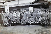 group in front of a factory Japan 1950s 1960s