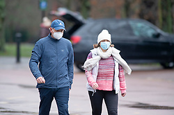 © Licensed to London News Pictures 16/01/2021.        Greenwich, UK. Two people wearing face masks walking round the park. The snowy weather turns to rain this afternoon with people getting out of the house from Coronavirus lockdown to exercise in Greenwich Park, London. Photo credit:Grant Falvey/LNP