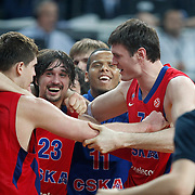 CSKA Moscow's Darjus Lavrinovic (R) and Alexey Shved (2ndL) celebrate victory during their Euroleague Final Four semi final Game 1 basketball match CSKA Moscow's between Panathinaikos at the Sinan Erdem Arena in Istanbul at Turkey on Friday, May, 11, 2012. Photo by TURKPIX