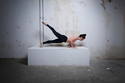 Mid adult woman practicing plank pose on concrete block, Munich, Bavaria, Germany