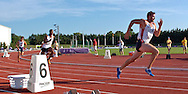 Paul Terek of the United States (R) flies out of the blocks followed by Germany's Jacob Minah (C) and USA's Chris Randolph (L) in the 400-meter dash, at the Nike Combined Events Challenge at the R.V. Christian Track Complex on the campus of Kansas State University in Manhattan, Kansas, August 5, 2006.
