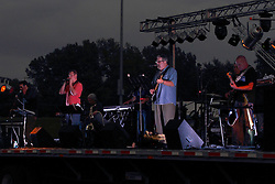 20 September 2014:   Marc Boon and the Unknown Legends perform at the Chris Brown Benefit Concert at the Corn Crib Stadium, Normal Illinois.  The band is comprised of 8 musicians: Marc Boon - front man and lead guitar, Jeff Young - drums, Ray Wiggs- keyboards, Aaron Garcia - trumpet-percussion-vocals, Burl Torner - guitar, Russell Zehr - saxaphone-guitar-keyboards-vocals, Chris Briggs - bass-vocals-keyboard, Jerry Abner - keyboards, ,