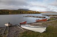 Small boats on the shore of lake Iraft in Adolfsström mountain village, Kungsleden Trail, Lapland, Sweden