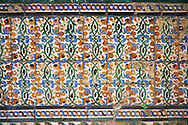 16th century Spanish Mudjar tiles from the Pavillion of Carlos V, Selivve Alcazar, Seville, Spain . The Royal Alcázars of Seville (al-Qasr al-Muriq ) or Alcázar of Seville, is a royal palace in Seville, Spain. It was built by Castilian Christians on the site of an Abbadid Muslim alcazar, or residential fortress.The fortress was destroyed after the Christian conquest of Seville The palace is a preeminent example of Mudéjar architecture in the Iberian Peninsula but features Gothic, Renaissance and Romanesque design elements from previous stages of construction. The upper storeys of the Alcázar are still occupied by the royal family when they are in Seville. <br /> <br /> Visit our SPAIN HISTORIC PLACES PHOTO COLLECTIONS for more photos to download or buy as wall art prints https://funkystock.photoshelter.com/gallery-collection/Pictures-Images-of-Spain-Spanish-Historical-Archaeology-Sites-Museum-Antiquities/C0000EUVhLC3Nbgw <br /> .<br /> Visit our MEDIEVAL PHOTO COLLECTIONS for more   photos  to download or buy as prints https://funkystock.photoshelter.com/gallery-collection/Medieval-Middle-Ages-Historic-Places-Arcaeological-Sites-Pictures-Images-of/C0000B5ZA54_WD0s