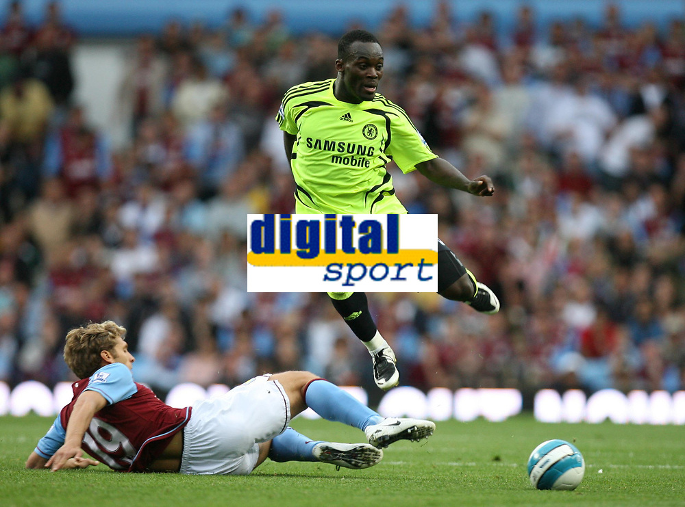 Photo: Rich Eaton.<br /> <br /> Aston Villa v Chelsea. The FA Barclays Premiership. 02/09/2007. Chelsea's Michael Essien leaps over the challenge of Stiliyan Petrov.
