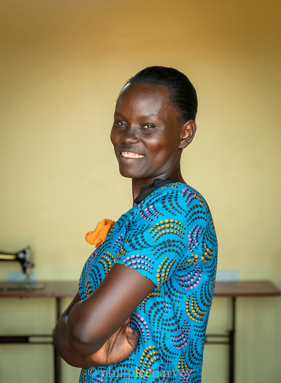 Portrait of mid adult woman trained as seamstress at Community Health Worker, Musoto, Mbale, Uganda