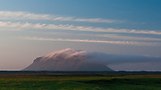 Cloud formations over Búrfell hill, Iceland