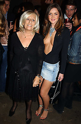 Left to right, JANET REGER and RUTH GIBBON at a party to celebrate a new collection of sexy underware by Janet Reger called 'Naughty Janet' held at 5 Cavendish Square, London on 19th October 2004.<br /><br />MINIMUM REPRODUCTION FEE - SEE OUR WEB SITE<br /><br />NON EXCLUSIVE - WORLD RIGHTS-