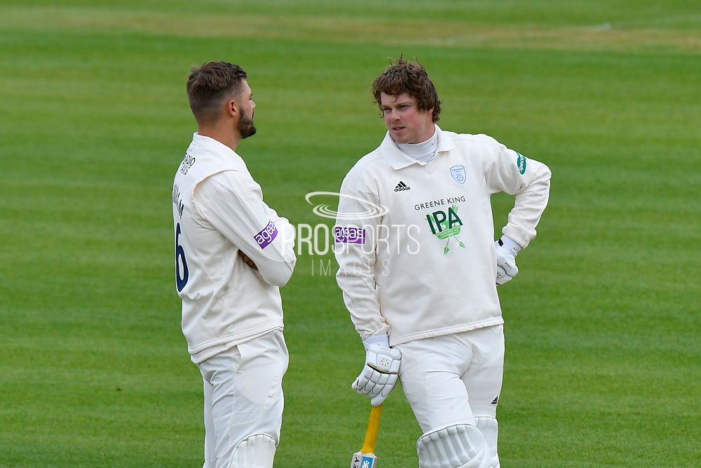 Aiden Markram of Hampshire talks with Sam Northeast of Hampshire during a break in play during the first day of the Specsavers County Champ Div 1 match between Hampshire County Cricket Club and Essex County Cricket Club at the Ageas Bowl, Southampton, United Kingdom on 5 April 2019.