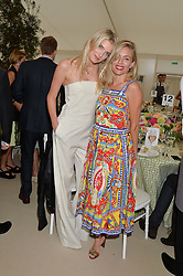 Left to right, LILY DONALDSON and SIENNA MILLER at the Cartier Queen's Cup Final 2016 held at Guards Polo Club, Smiths Lawn, Windsor Great Park, Egham, Surry on 11th June 2016.