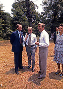After a Sunday church service in Plains, Georgia President Jimmy Carter, Vice President Walter Mondale and wife, Joan talk with US Secret Service Agent Charles Zboril (left), Carter's lead protection agent. Zboril was a young agent scheduled to be on the back of President John F. Kennedy's limousine on the day he was assassinated in Dallas, Texas.- To license this image, click on the shopping cart below -