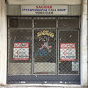 A closed down video club/ call shop in Aristotelous Str, Athens