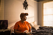 MONTGOMERY, AL – JUNE 11, 2019: Myra Powell, 21, looks through the memories of her twin boys inside her apartment in the Capitol Heights neighborhood. At age 19, while 26 weeks pregnant, Powell suffered a catastrophic placental abruption and was taken by ambulance to a nearby hospital. While there, doctors discovered her placenta had fully detached from the uterine wall, depriving her twin boys of oxygen. Silas and Stefvon died in utero. Narrowly escaping death herself, Powell would later be diagnosed with HELLP syndrome, a pregnancy-induced blood pressure condition in the eclampsia family that kills nearly a third of all women who develop it. As a young, poor, black woman from the south, Powell represents the deadliest cross-section of demographics among mothers in America, where more women die from pregnancy related causes than any other wealthy country in the world.