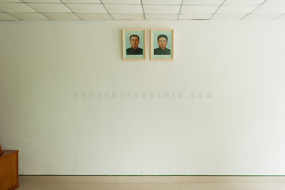 Images of Kim Il Sung and Kim Jong Il on a wall at Panmunjom border station, DPRK (North Korea)