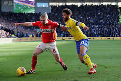 Middlesbrough's Adam Clayton (left) and Leeds United's Tyler Roberts during the Sky Bet Championship match at The Riverside Stadium, Middlesbrough.