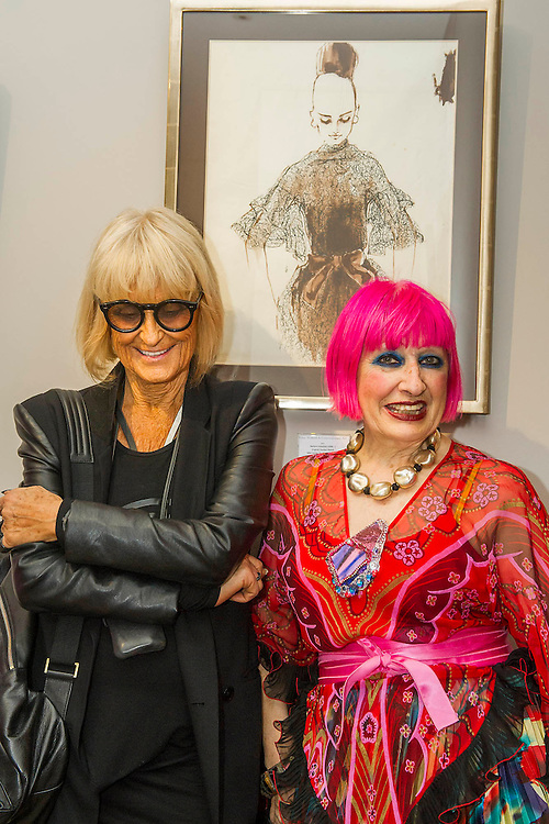 Dame Zandra Rhodes (R) and Barbara Hulanicki (BIBA in black) attend the Private view for Drawing on Style: Four Decades of Elegance - an exhibition of original vintage fashion illustrations from Post War 1940s through to the 1970s organized by GRAY M.C.A, leading specialists in Fashion Illustration.  It includes more than 40 original works by some of the leading illustrators of the time from Britain, Europe and America including René Bouché, René Gruau and Carl Erickson for publications including Vogue as well as advertising work for L'Oreal and other famous names in Haute Couture.  There are also a selection of original designs by designers including Dior, Biba & Zandra Rhodes. Coinciding with London Fashion Week, the exhibition runs from Thursday 11th - Tuesday 16th September 2014 with prices from £300-£10,000. Gallery 8, St James's, London. 10 Sept 2014. Guy Bell, 07771 786236, guy@gbphotos.com