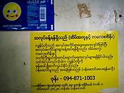 28 MAY 2018 - BANGKOK, THAILAND: Signs in Thai and Burmese in Phra Khanong Market in Bangkok. The market serves a mix of Thai working class people and immigrants from Myanmar (Burma).      PHOTO BY JACK KURTZ
