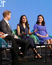 (left to right) Prince Harry, Meghan Markle and the Duchess of Cambridge during the first Royal Foundation Forum in central London.