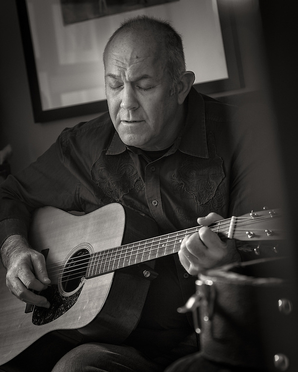 """Mark Rosenthal singing and playing the guitar at his Louisville home. Mark is a member of the Celtic group """"Cloigheann"""". You will also find Mark performing with the Louisville based string band """"Dozens of Dollars""""."""