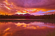 Canadian Rocky Mountains reflected in at Lac Beauvert at sunset, Jasper National Park, Alberta, Canada