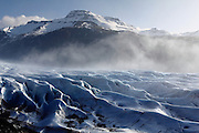 The Svínafellsjökull glacier pours down from the massive Vatnajökull ice-field in South-East Iceland. Fog was drifting over the glacier and mountains behind.