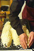 How to prepare fish baked in the oven in salt crust (en croute de sel), recipe, series of pictures: three fish covered in salt crust before being baked in the oven, a man putting the final touch on the crust Clos des Iles Le Brusc Six Fours Cote d'Azur Var France