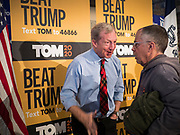 29 JANUARY 2020 - KNOXVILLE, IOWA: TOM STEYER, left, talks to a person at a campaign event in Knoxville, about 40 miles southeast of Des Moines, Wednesday. About 60 people attended the campaign meet and greet. Steyer, a California businessman, is campaigning to be the Democratic nominee for the US Presidency in 2020. Iowa holds the first selection event of the 2020 election cycle. The Iowa Caucuses are Feb. 3, 2020.        PHOTO BY JACK KURTZ
