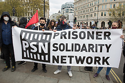 London, UK. 1st May, 2021. Supporters of the Prisoner Solidarity Network stand behind a banner at a Kill The Bill demonstration in Trafalgar Square as part of a National Day of Action to coincide with International Workers Day. Nationwide protests have been organised against the Police, Crime, Sentencing and Courts Bill 2021, which would grant the police a range of new discretionary powers to shut down protests.