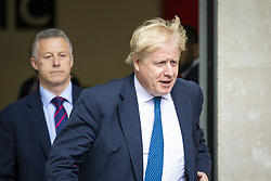 April 15, 2018 - London, London, UK - London, UK. Foreign Secretary BORIS JOHNSON (R) leaves BBC Broadcasting House after appearing on the Andrew Marr Show. (Credit Image: © Rob Pinney/London News Pictures via ZUMA Wire)